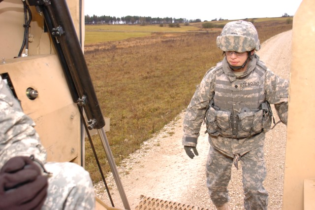 Spc. Josue De Aquino, a logistics support specialist with the 16th Sustainment Brigade, boards the back of a Mine Resistant Ambush Protected vehicle after conducting drivers' training on the vehicle at Grafenwoehr Dec. 8. Soldiers from the 16th Sust. Bde. trained on the MRAP vehicles to familiarize themselves with one of the Army's newest armored personnel carriers.