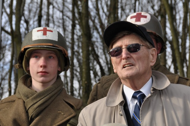 "A local re-enactor pays tribute to the 326th Airborne Medical Company at a ceremony dedicated to their sacrifices. Henry ""Hank"" Skowronski fought with the unit during the Battle of the Bulge and was taken prisoner by the Germans 65 years ago."
