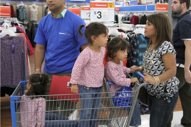 "Wounded Warrior Hugo Gonzalez and his family prepare to shop for up to $1,000 of Christmas cheer donated by Walmart and Operation Home Front.  Gonzalez scouted the store for more than an hour planning his mission, some sold out items will require him to return to the store with out the children present to ""keep the surprise"" of Christmas intact."