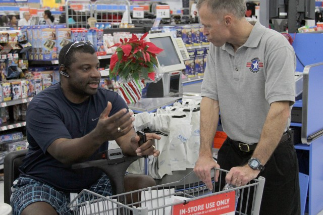Staff Sgt. Anthony Kirsh, a Wounded Warrior with U.S. Southern Command, talks shop with Keith Seago, member of the Operation Home Front, Florida board of directors.