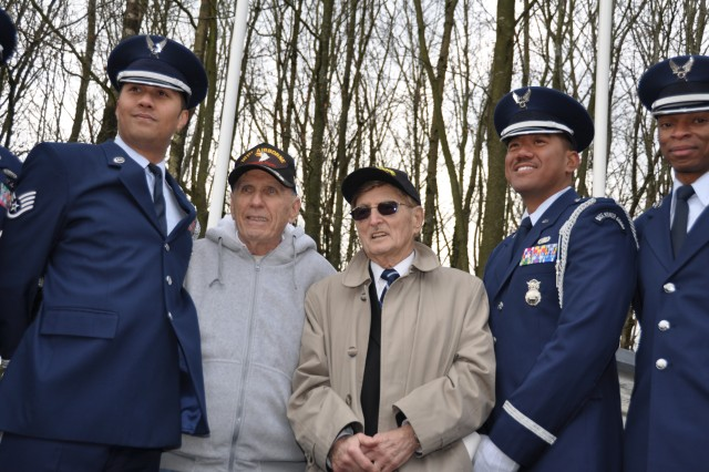 "World War II veterans Carmen Gisi and Henry ""Hank"" Skowronski pose with Staff Sgt. Richard Keidle, Capt. Winell Demesa and Tech. Sgt. Mike Jackson from the U.S. Air Force 52nd Fighter Wing Honor Guard. The men gathered in Sainte-Ode, Belgium, Dec. 13, 2009, to unveil a new monument for the 326th Airborne Medical Company, 101st Airborne Division. Both veterans fought in that location during the Battle of the Bulge in 1944."
