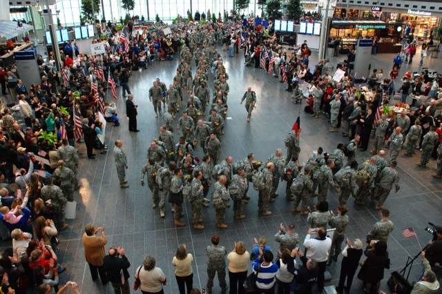 Guard Soldiers return to Indianapolis airport