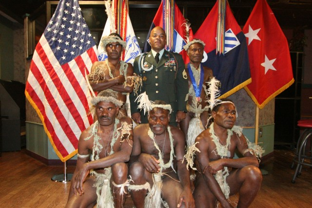 "Staff Sgt. Steve Shepard of the 3rd Infantry Division poses with the five Pacific Islanders he welcomed to his home as part of the Travel Channel's ""Meet the Natives: USA"" series. The episode is set to air Sunday Dec. 20 at 10 p.m. EST."