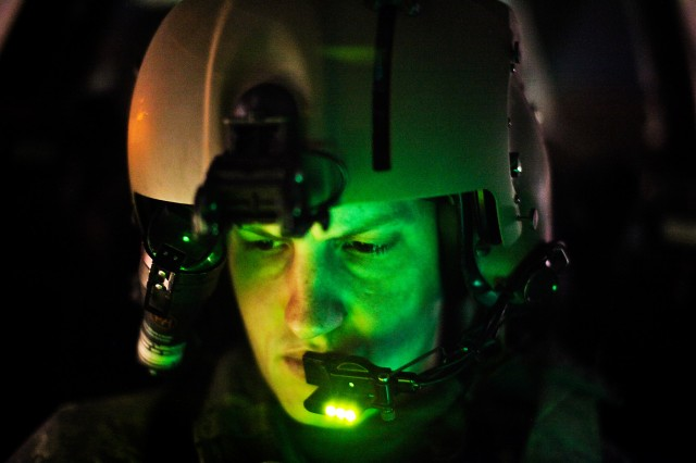 Chief Warrant Officer Aaron Fouquette, from Jacksonville, Fla., an AH-64D Apache attack helicopter instructor pilot in 4th Battalion, 227th Aviation Regiment, 1st Air Cavalry Brigade, 1st Cavalry Division, conducts systems checks on an Apache before ...