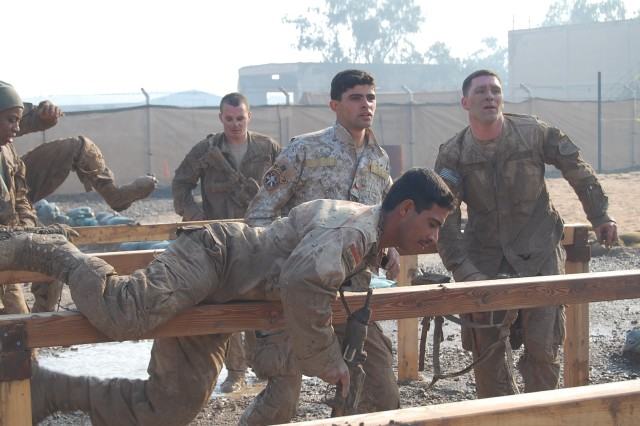 CAMP TAJI, Iraq - Iraqi Army Soldiers from the Field Engineering Regiment, 11th IA Division, push themselves through the last obstacle course, before becoming the first Iraqi Soldiers to complete the Spur Ride with the 1st Brigade Special Troops Battalion, 1st Brigade Combat Team.  The partnership between these units has allowed for greater training and learning opportunities.