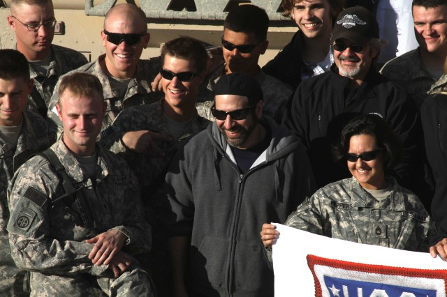 091216-A-2388D-168 Comedian Dave Attell, center, visits Paratroopers from 4th Brigade Combat Team (Task Force Fury), 82nd Airborne Division Dec. 12 during a USO tour in Kandahar Airfield, Afghanistan. Attell other celebrities chatted with Soldiers and signed autographs to raise morale among troops serving overseas. (U.S. Army photo by Sgt. Stephe Decatur)