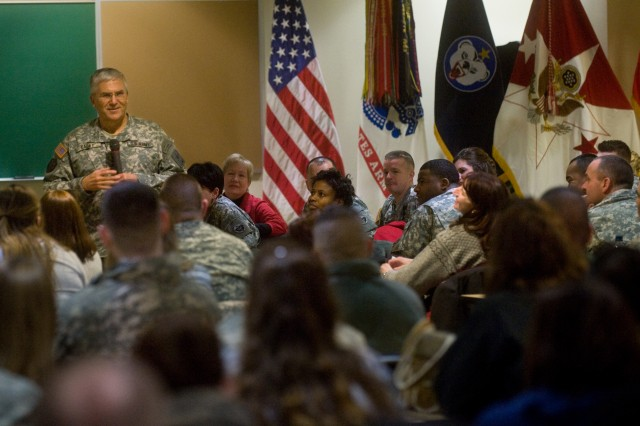 Chief of Staff of the Army Gen. George W. Casey Jr. talks with families and Soldiers of U.S. Army Alaska, during a town hall at Fort Richardson, Alaska, Dec. 14, 2009. Casey addressed current events within the Army and then opened the discussion for questions from the audience of approximately 200.