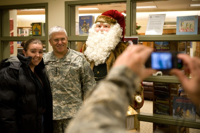 Chief of Staff of the Army Gen. George W. Casey Jr. at Fort Richardson, Alaska, poses for a picture with an Army wife, whose husband is deployed in Afghanistan, on Dec. 14, 2009. Casey is in Alaska as part of his around the world troop visit.