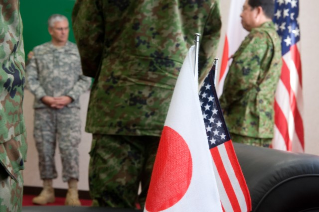 Japanese Army Lt. Gen. Saiki speaks after being presented the a Legion of Merit from the Chief of Staff of the Army Gen. George W. Casey Jr. at Camp Higashi-Chitose, Japan, Dec. 16, 2009. Saiki was given the award for his work and leadership involved with Yama Sakura 57.