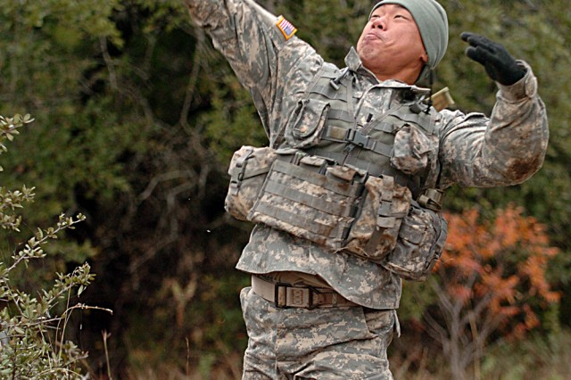 1st Lt. David Kim of Los Angeles, assigned to Co. B, 2nd Battalion, 7th Cavalry Regiment, throws a grenade Dec. 4, during his unit's spur ride on Fort Hood, Texas.