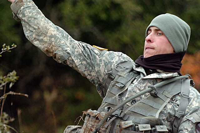 Staff Sgt. Nick Crawford of Asheville, N.C., assigned to Co. B, 2nd Battalion, 7th Cavalry Regiment, throws a grenade Dec. 4, during his unit's spur ride on Fort Hood, Texas.
