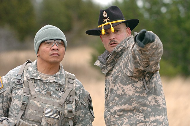 Maj. Tito Villanueva of San Antonio, Texas, of 2nd Battalion, 7th Cavalry Regiment receives instruction from a senior spur holder Dec. 4, during his unit's spur ride on Fort Hood, Texas.