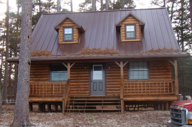 Mwr opens new cabin at elliott lake article the united for Three story log cabin