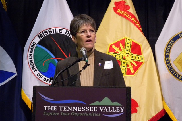 """Teresa W. Gerton, acting executive deputy to the commanding general, Army Materiel Command, updates the Tennessee Valley on the status of AMC's BRAC move to Redstone Arsenal, Ala., Dec. 15 during BRAC to the Future III."""""""