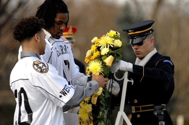 U.S. Army All-American Bowl football players Dillon Baxter and Seantrel Henderson lay a wreath at the Tomb of the Unknowns with assistance from an Honor Guard Soldier Monday afternoon. They are two of the six finalists nominated for Army All-American player of the year and will play in the bowl game Jan. 9.