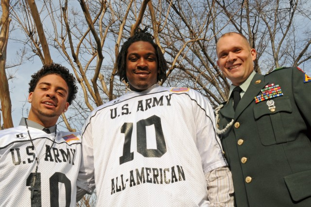 All-American Bowl players Dillon Baxter and Seantrel Henderson pose outside the Pentagon with Army NCO of the Year Sgt. 1st Class Aaron Beckman.