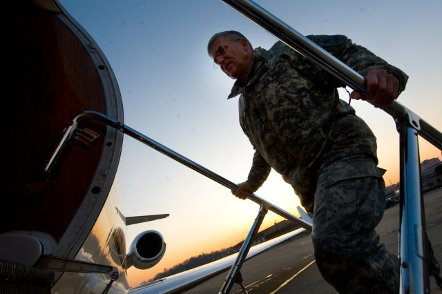 Chief of Staff of the Army, Gen. George W. Casey Jr.,  boards the plane at Osan Air Base, S. Korea, en route to Kabul, Afghanistan, Dec. 16, 2009.