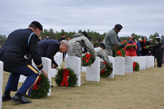 Wreaths Across America, with the help of volunteers from across the Columbia area, laid more than 300 wreaths at graves at the Fort Jackson National Cemetery.