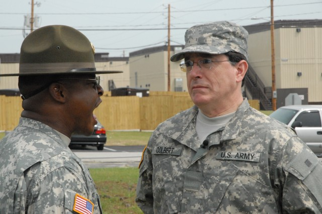 Sgt. 1st Class Demetrius Chantz, Drill Sergeant School, yells at political humorist Stephen Colbert for the filming of a segment of Colbert's show on Fort Jackson in May.