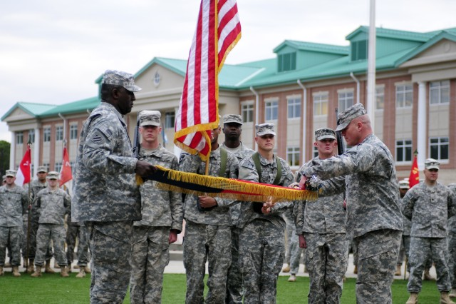 First Heavy Brigade Combat Team Command Sergeant Major Edd Watson and Col. Roger Cloutier, 1st HBCT commander, roll up the brigade Colors at Marne Gardens, Dec. 11.