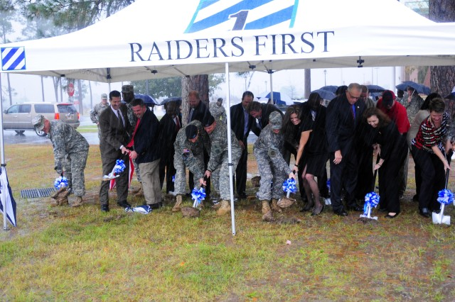 Various donors to the Raider Brigade Fallen Soldiers Memorial break the ground for the memorial site outside 1st HBCT's new headquarters building, Dec. 9.