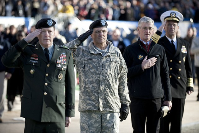 Lt. Gen. Franklin Hagenbeck, Superintendent of the U.S. Military Academy; Gen. George Casey, Jr., U.S. Army Chief of Staff; Secretary of the Army John McHugh; and Navy Adm. Mike Mullen, chairman of the Joint Chiefs of Staff, present honors during the playing of the National Anthem at the 110th playing of the Army-Navy football game at Lincoln Financial Field, Philadelphia, Pa., Dec. 12, 2009.