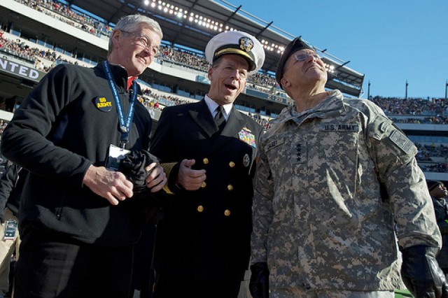 Army Secretary John McHugh; Navy Adm. Mike Mullen, chairman of the Joint Chiefs of Staff; and Army Chief of Staff Gen. George Casey, attend the 110th playing of the Army-Navy football game at Lincoln Financial Field in Philadelphia, Dec. 12, 2009.