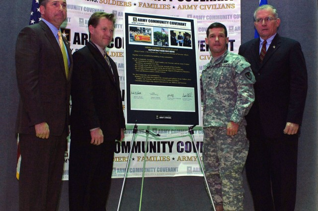 From left to right, New York State Director of Veterans' Affairs, retired Army Col. James McDonough; City of Watervliet Mayor, Michael Manning; Watervliet Arsenal Commander, Col. Scott N. Fletcher; and Albany County Executive, Michael Breslin stand in front of the recently signed Community Covenant.""