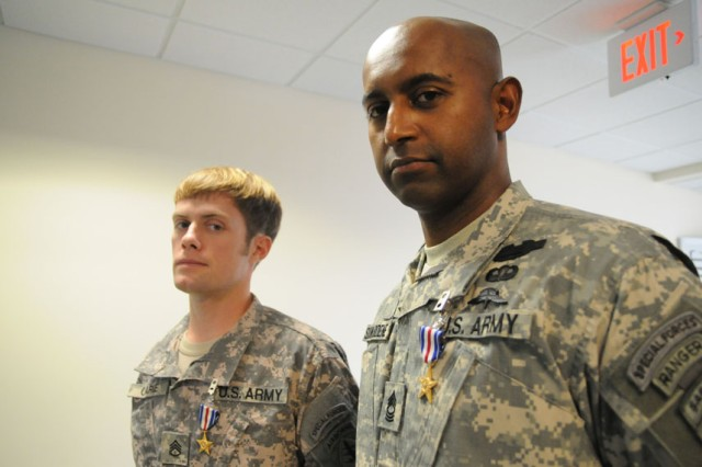 Master Sgt. Anthony M. Siriwardene, right, and Staff Sgt. Linsey W. Clarke, both with 3rd Special Forces Group, were awarded the Silver Star for valor in combat during an awards ceremony held Wednesday in the John F. Kennedy Auditorium.