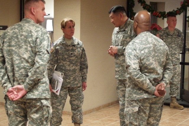 Lt. Gen. Joseph Peterson, U.S. Army Forces Command deputy commanding general and Honolulu, Hawaii, native, briefs Col. Robin Akin, 3d Sustainment Command (Expeditionary) commander, Col. Jerrold Reeves, 3d ESC deputy commander, and Command Sgt. Maj. Willie Tennant, 3d ESC senior enlisted leader, on issues and expectation during the reset and retrain process. During his visit to the 3d ESC, Peterson thanked Soldiers of the command for their diligence during the reset and retrain process, which he described as being especially difficult for logisticians. (U.S. Army photo by Spc. Michael Behlin)