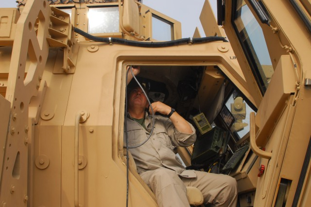 Kinechen Eason, an electrical technician with Computer Science Corps, installs the Boomerang acoustic shooter-detection system control panel in a Mine Resistant Ambush Protected vehicle at Contingency Operating Base Basra, Nov. 27. The system detects gunfire and alerts Soldiers audibly and visually to the shooter's distance and direction.