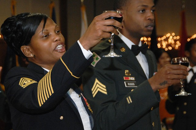 Noncommissioned Officers at U.S. Army Garrison Humphreys, Korea culminated their Year of the NCO events with a ball on Dec. 11. Here, Command Sgt. Maj. Nichelle S. Fails (left) of the 194 Combat Service Support Battalion leads a toast.