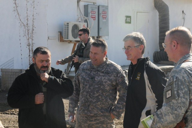 "Secretary of the Army John McHugh talks with Brig. Gen. Frederick ""Ben"" Hodges, director of operations for Regional Command - South (far right), Col. Brian M. Drinkwine, and the Afghan commander he is partnered with at Forward Operating Base Sweeney in the Zabul province of Afghanistan, Dec. 16, 2009."