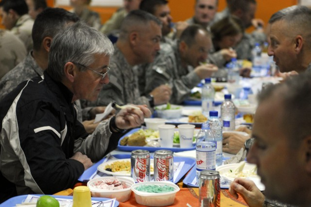 Secretary of the Army John McHugh shares a meal with Soldiers at Luxembourg Dining Facility on Kandahar Airfield, Afghanistan, Dec. 16, 2009.