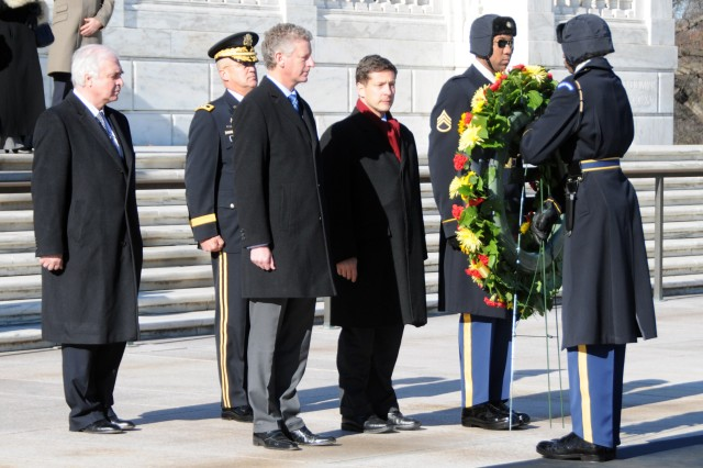 Belgian Minister of Defense, Pieter De Crem, and Nicolas Mackel, deputy chief of mission, Embassy of the Grand Duchy of Luxembourg, lay a wreath at the Tomb of the Unknowns in Arlington National Cemetery, on Dec. 16 -- the 65th anniversary of the start of the Battle of the Bulge.