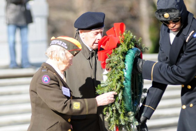 Veterans of the Battle of the Bulge lay a wreath at the Tomb of the Unknowns in Arlington National Cemetery, on Dec. 16 -- the 65th anniversary of the start of the battle.