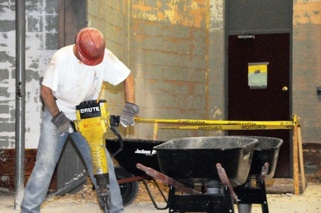Grier Walker of Whitesell-Green, Inc./Yates and Sons cuts through concrete with a jackhammer Dec. 9 while renovating the Fort Rucker Physical Fitness Facility. Project supervisors said construction is progressing as scheduled.