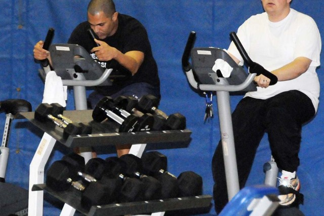 Patrons use equipment at its current Fort Rucker Physical Fitness Facility location Dec. 9. Equipment was moved to the gymnasium so crews could renovate the old room.