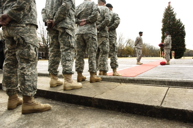 Soldiers stand in line to show their respects to the 163 Georgia servicemembers killed in support of freedom in Iraq and Afghanistan during the Soldiers' Tree lighting ceremony held Dec. 11 at Hedekin Field. Family members and Civilian employees also partook in the event to recognize the sacrifices made to keep America safe. For the story and photos, see pages 8 and 9.