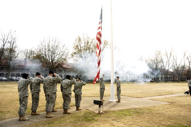 Soldiers render honors as the flag is lowered at the start of the ceremony. Honor continued to be displayed throughout the event, a tribute to those who gave all to defend freedom.