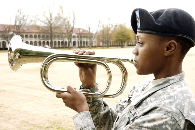 Spc. Gloria Simpson, a human resource specialist with the Third Army/U.S. Army Central Augmentation Company, plays Taps during the conclusion of the ceremony.