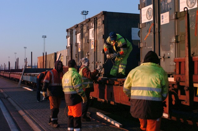 A team of workers prepare containers for shipment by rail at the port of Antwerp, Belgium, Dec. 15. The containers are part of the 172nd Infantry Brigade's redeployment inventory. The 838th Transportation Battalion, civilian contractors and the 21st Theater Sustainment Command combined forces to complete the port operations mission for the 172nd Inf. Bde.