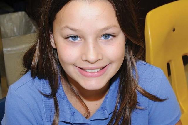 "Faith Christinson, 10, fifth grade. ""I want a cell phone - a touch phone."""