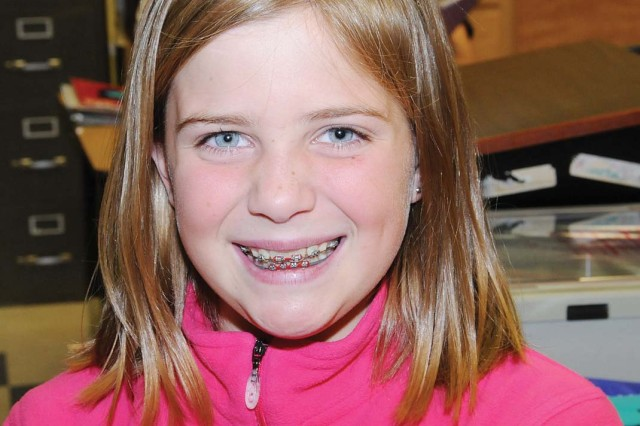 """Emily Forrest, 10, fifth grade. """"I want a golden retriever puppy, a turtle, a cell phone, a laptop and a Baby Alive (doll)."""""""