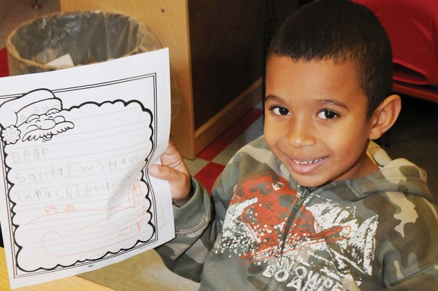 "Clyde Brown, 5, kindergarten. ""I want a spider toy with a control and a car with a track."""
