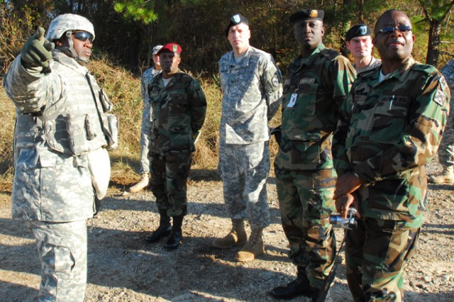 SFC Julius Bryant, with the 11th Engineer Battalion, explains bridge operations to the Liberian delegation Dec. 10.  The delegates, accompanied by COL A.L. Rumphrey, of the U.S. African Command, got a firsthand look at officer and NCO interactions, which they hope to model in the Armed Forces of Liberia's ranks.