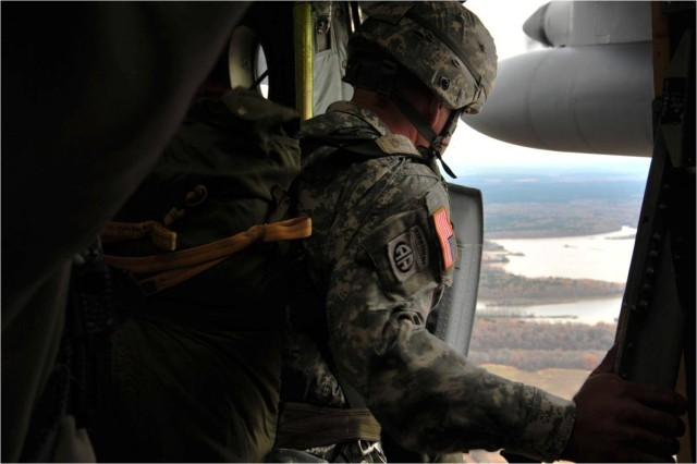 An Airborne School instructor and Operation Just Cause veteran checks to see how close the aircraft is to the drop zone.