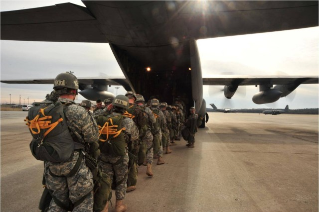 U.S. Army Airborne School students from B Company, 1st Battalion (Airborne), 507th Parachute Infantry Regiment, load up into a C-130 for a combat jump with veterans of Operation Just Cause.