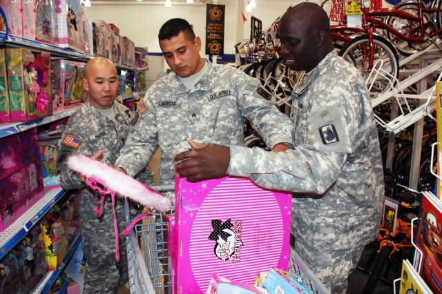 (From left) Sgt. 1st Class Viet Nguyen, Sgt. Jesus Garcia and Sgt. Kendrell Marshall, of the 14th Military Intelligence Battalion, select toys at the Fort Sam Houston PXtra store Dec. 15. They purchased $900 worth of toys for the U.S. Marine Corps Reserve's Toys for Tots program. The money came from the approximately 260 battalion members deployed to Iraq since last summer. (U.S. Army photo by Gregory Ripps, 470th Military Intelligence Brigade Public Affairs/Released)
