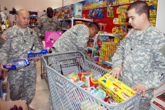 (From left) Sgt. 1st Class Viet Nguyen, Sgt. Kendrell Marshall, Sgt. Jesus Garcia and Spc. Christopher Sizemore, of the 14th Military Intelligence Battalion, select toys at the Fort Sam Houston PXtra store Dec. 15. They purchased $900 worth of toys for the U.S. Marine Corps Reserve's Toys for Tots program. The money came from the approximately 260 battalion members deployed to Iraq since last summer.(U.S. Army photo by Gregory Ripps, 470th Military Intelligence Brigade Public Affairs /Released)
